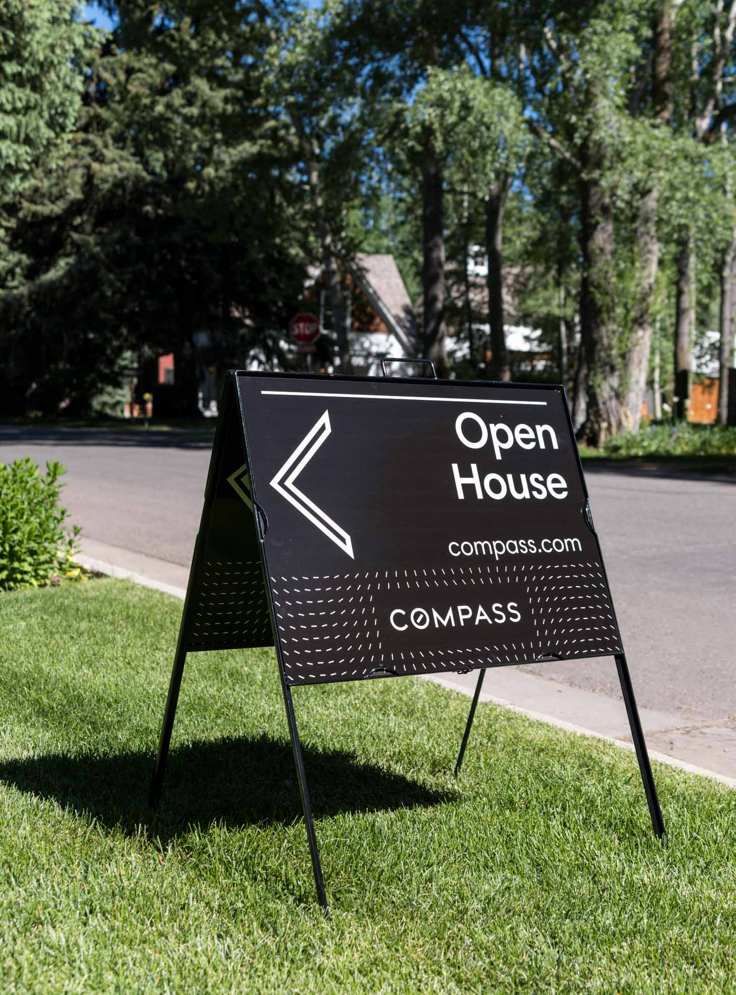 Open House sign with Compass' unique branding